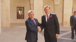 King Abdullah of Jordan greets Prime Minister David Cameron