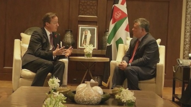 Prime Minister David Cameron speaks with Jordan's King Abdullah