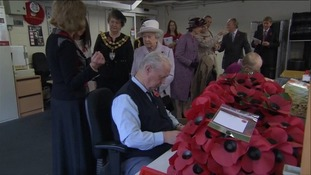 Queen visits poppy factory in Surrey.