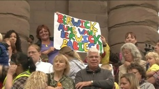 Hundreds protested when services were initially suspended