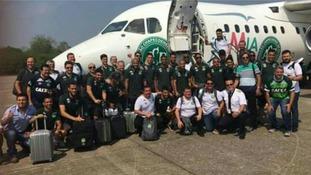 The Chapecoense football team poses outside the doomed aircraft