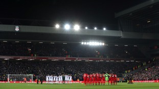Leeds and Liverpool players observe a minutes silence at Anfield.