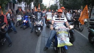 Greek workers with motorcycles and flags take part in an anti-austerity  protest ride