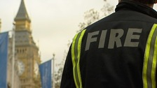 A firefighter in the shadow of Big Ben lobbying against cuts to the fire service