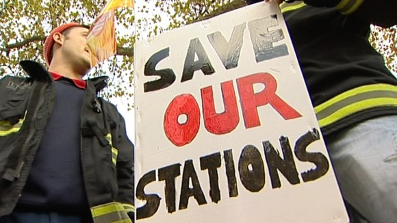 Placards against the closure of fire stations which union members say will happen if the service is cut further