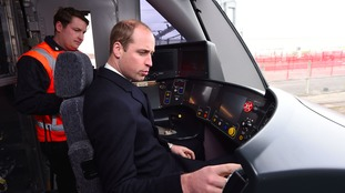 Prince William driving a train