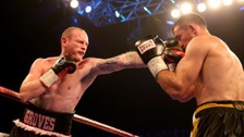 Eduard Gutknecht (right) remains in a coma after losing to George Groves at Wembley.