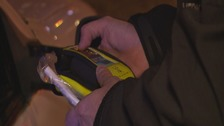 Police officer holding an alcohol testing kit