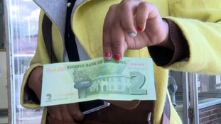 Zimbabwe prints own money for first time in a decade
