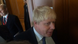 Boris Johnson was speaking outside a migration conference in Rome.