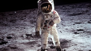 Buzz Aldrin walking on the moon in 1969.