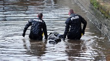 Police divers recover a man's body from the Rochdale canal in Ancoats