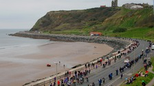 The peloton of riders on the Marine Drive in Scarborough during stage three of the Tour de Yorkshire.