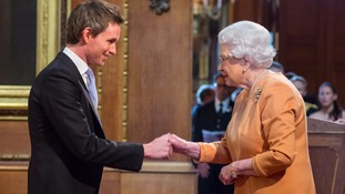 Eddie Redmayne and Tim Peak received honours from the Queen at Windsor Castle