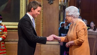 Eddie Redmayne is awarded an OBE by the Queen