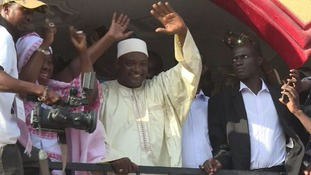 Gambians cheered their new president as he waved to the crowds from a balcony after his victory.