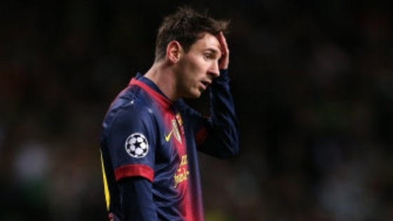 Barcelona's Lionel Messi stands dejected