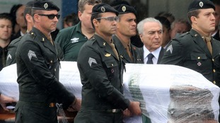 Brazil's President attends repatriation of plane crash victims ahead of memorial