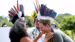 Prince Harry fitted in feather headdress on last day of Caribbean tour