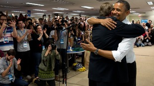 President Obama hugs his campaign manager, Jim Messina, during an unannounced stop at his campaign headquarters in Chicago.