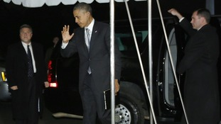 President Obama waves to reporters as he makes his way back to the White House.