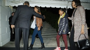 President Obama and his family on arrival in Washington.
