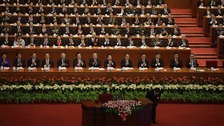 Delegates applaud as China's President Hu bows after a speech at the opening ceremony of 18th National Congress of Communist Party of China.