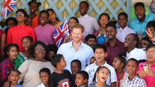 Prince Harry visits children's home run by 'Moonies'