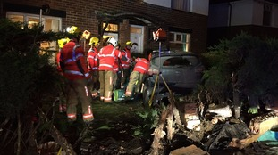 Three people rescued after car crash in Rochdale garden