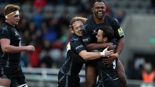 Newcastle Falcons Michael Young celebrates with teammates Vereniki Goneva and Joel Hodgson during the Aviva Premiership match at Kingston Park, Newcastle.