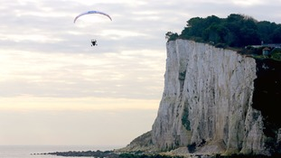 Sasha Dench flying into Dover in her paramotor