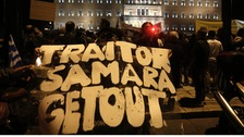 "A protester holds a banner reading ""Traitor Samara get out""(Greece's Prime Minister Antonis Samaras )in front of the parliament ."
