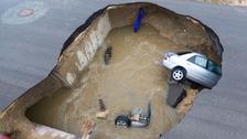 Off-duty sheriff's deputy killed as huge sinkhole opens up in road