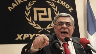 Nikolaos Michaloliakos, leader of the Golden Dawn party speaks during a news conference