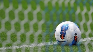 A football in front of a net