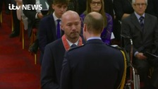 Alan Shearer receives CBE from Prince William