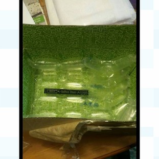 A mascara in bubble wrap and a box.