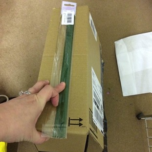 A pack of floristry wire in a huge cardboard box.