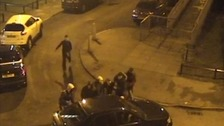Vicious street brawl between armed attackers