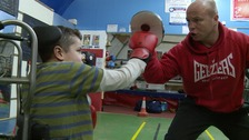 Boxing champion trains children with disabilities