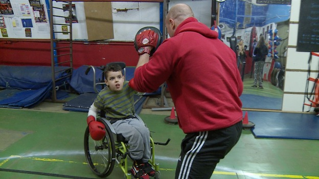 Boxing champion jon thaxton teaches disabled children how