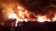 Fire crews tackle huge fire at Lancashire car scrap yard