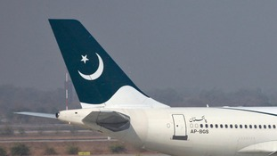A The Pakistan International Airlines plane tail