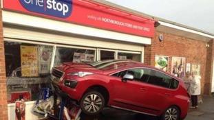 Car hits shop.