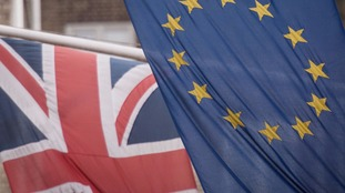 The Union Flag and the flag of the EU.