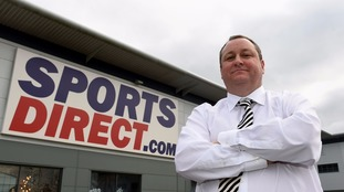 Founder Mike Ashley outside Sports Direct, which has suffered from plummeting profits