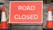 A road is closed due to vehicle fire