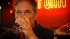 man drinking drink