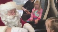 Santa speaks in sign language to three-year-old girl