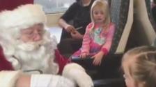 Santa speaks in sign language to three-year-old girl